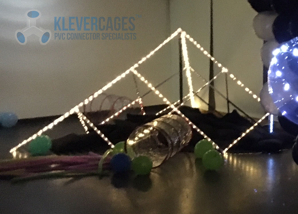 Clear 20mm Connectors to fit PVC plumbing pressure pipe or clear PVC pipe from Klever Cages used to make a Pyramid for kids with led lights at an art gallery