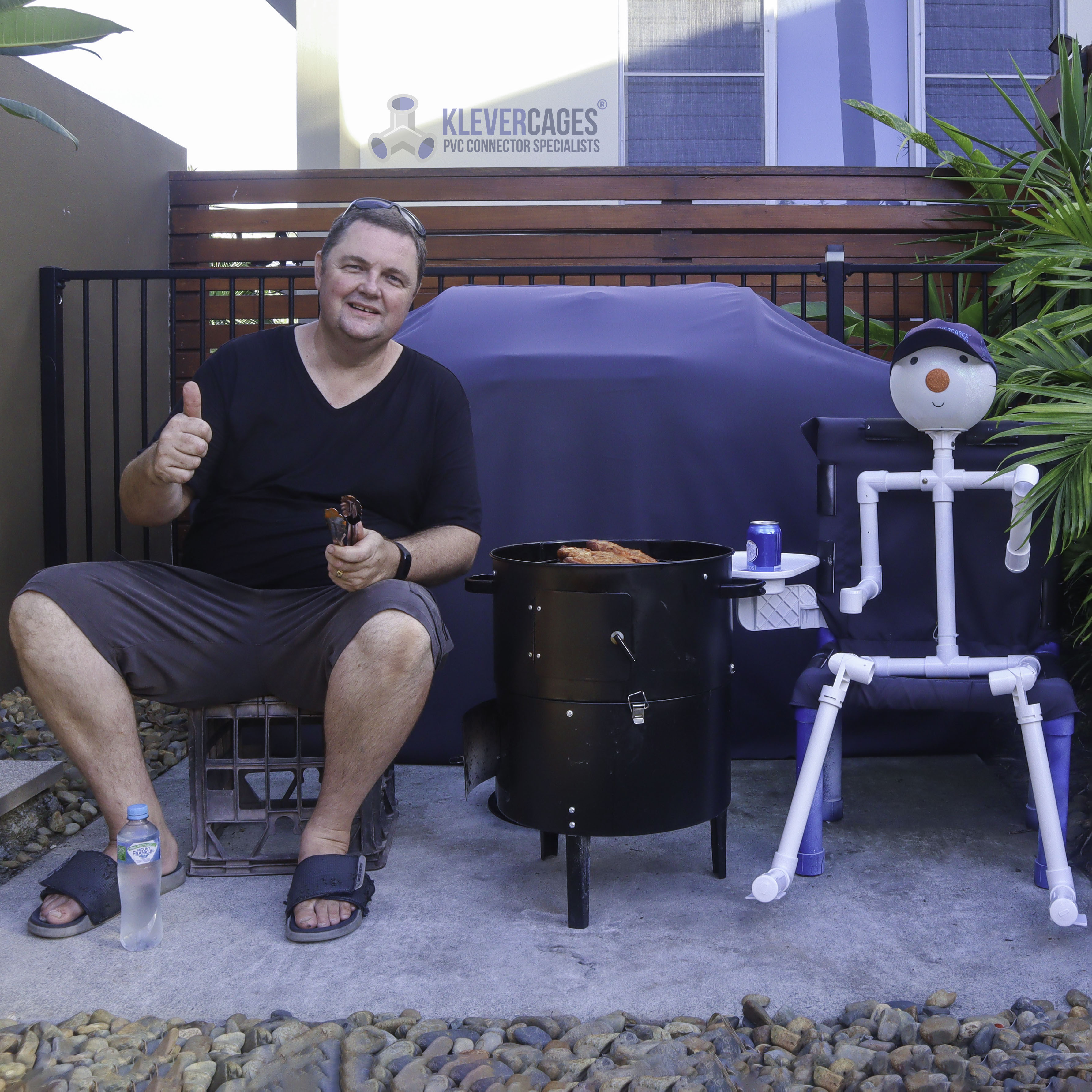 Connector Cam (PVC pipe person) and I sitting by the BBQ cooking dinner and having a chat. Connector Cam is built from PVC fittings and PVC pipe from Klever Cages