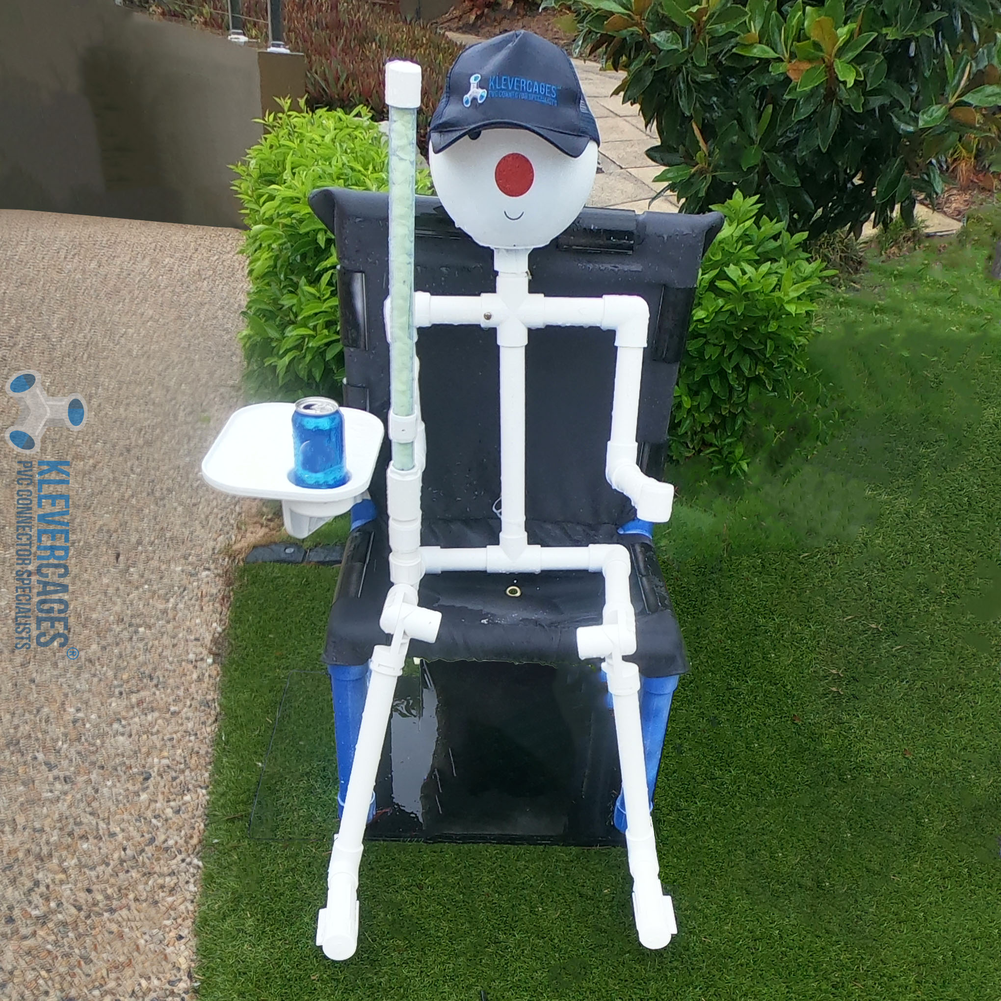 Connector Cam PVC pipe person sitting on a chair with a drink and a hat. Built from PVC fittings and PVC pipe from Klever Cages