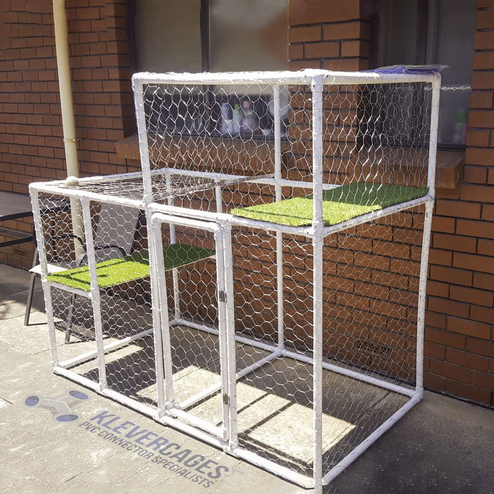 DIY customer designed and built cat enclosure with different levels covered with fake grass for the cat to rest on. Built with PVC connectors, 3 ways, elbows, tees, crosses and pvc pipe as the frame covered with chicken wire