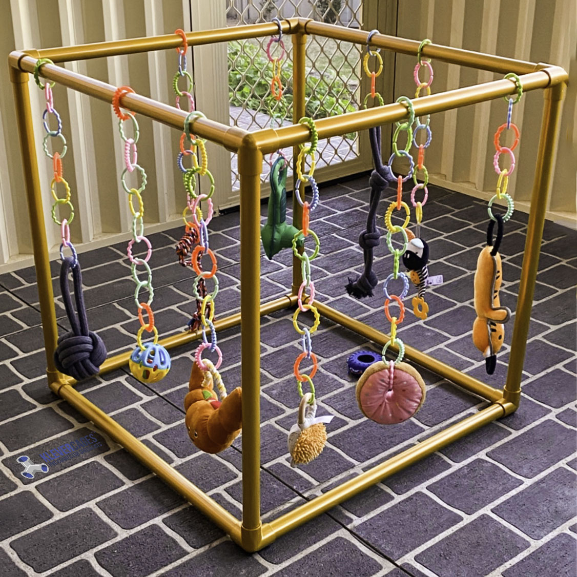 Build your own puppy, cat play cub, box, activity centre from 3 way PVC connectors and PVC pipe, then hang your  fur-babies favourite toys from the frame