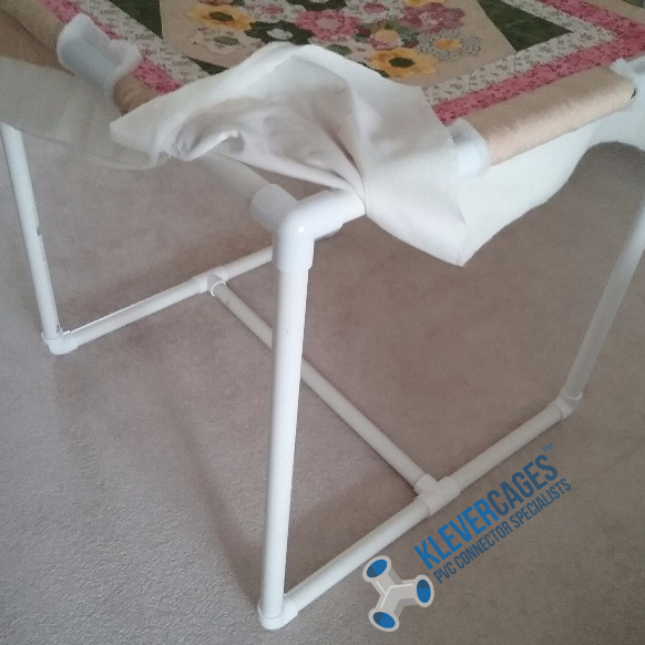DIY quilting table built with tees, elbow and 3 way connector fittings and PVC pipe from Klever Cages