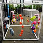 Make your own dog-toy-puppie-play-cube-made-from-3-way-pvc-connectors-and-pipe-from-klever-cages. Hang their favorite toys just like this one