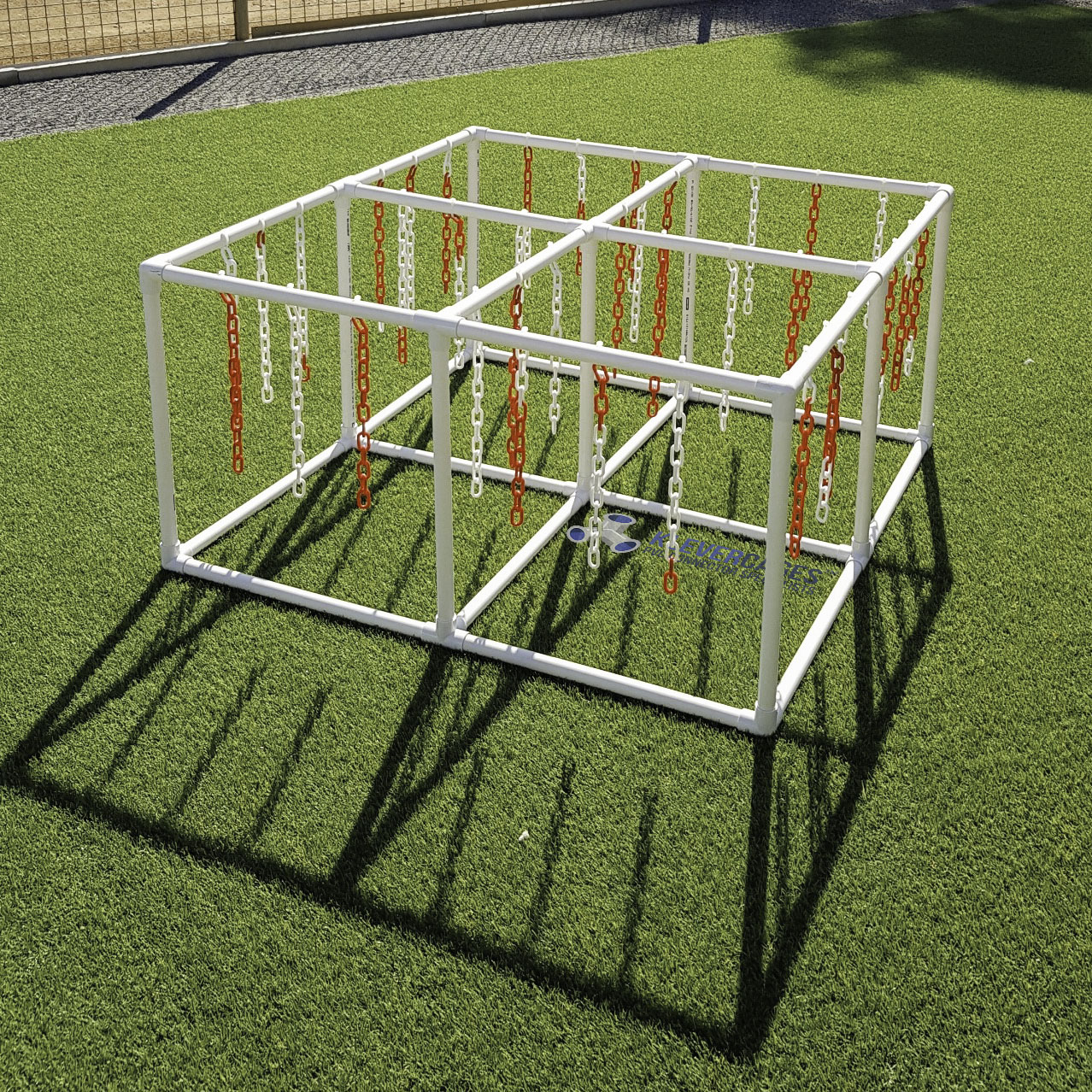 Easy to build puppy cat play activity gym. Built with PVC connectors and pipe from Klever Cages. Plastic chains hanging and set on green grass