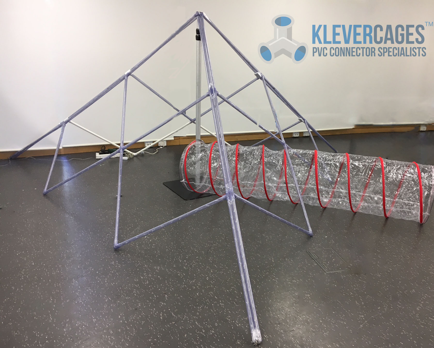 A pyramid with led lights using clear PVC connectors, 3 ways and crosses and clear pipe from Klever Cages