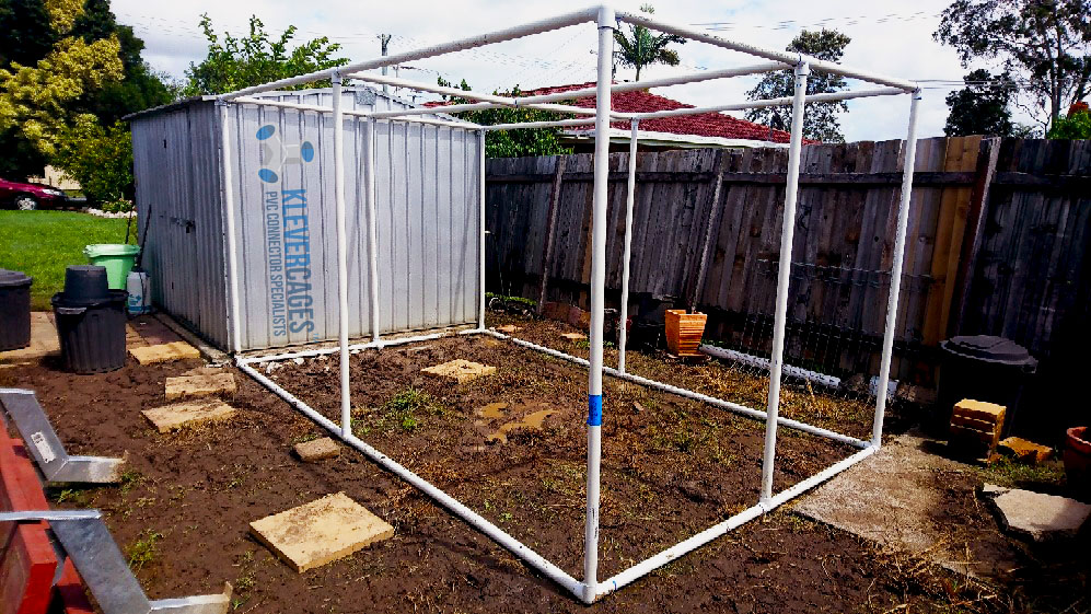 Shadehouse frame attached to a garden shed built with 40mm pipe and 3 way elbow connectors from Klever Cages. Giving the frame the strength it needs