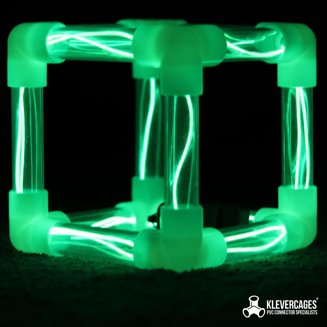 Glow in the dark 3 way elbow connector fittings with clear rigid PVC pipe and green led lights in them to form a cube