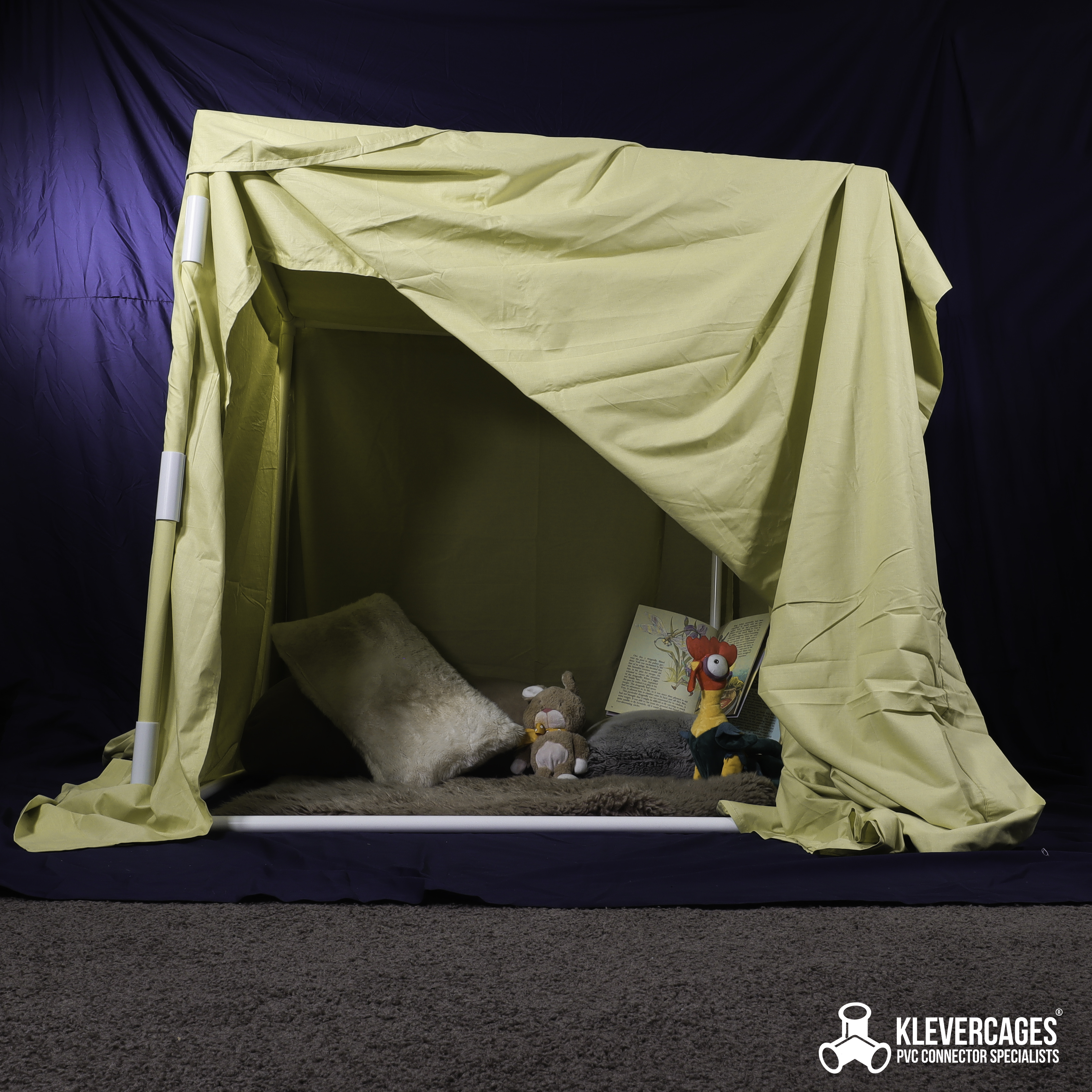 kids indoor cubby built with PVC pressure pipe, 3 way connectors, snap clamps and sheets for a quiet place for children to read, play and rest