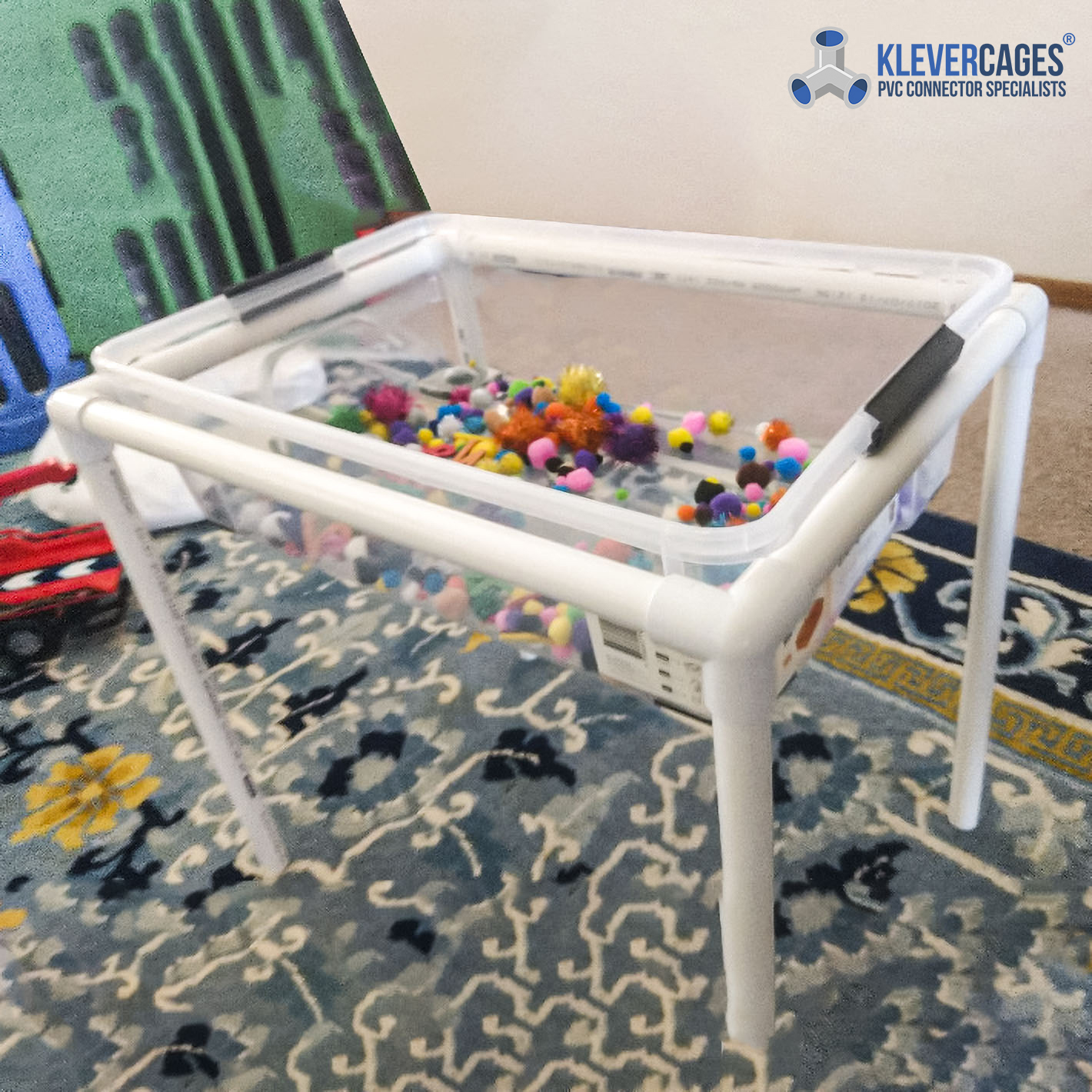 Childrens sensory play table built with 3 way fitting connectors and PVC pipe from Klever Cages