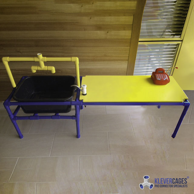 kids water play table built with tees, l-tees-3 way elbow fittings connectors and PVC pipe from Klever Cages