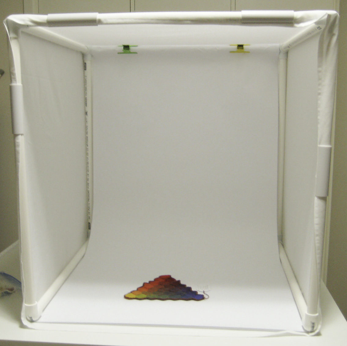 Photography light box built with 3 way PVC connectors, snapclamps to keep the material tight and PVC pipe from Klever Cages