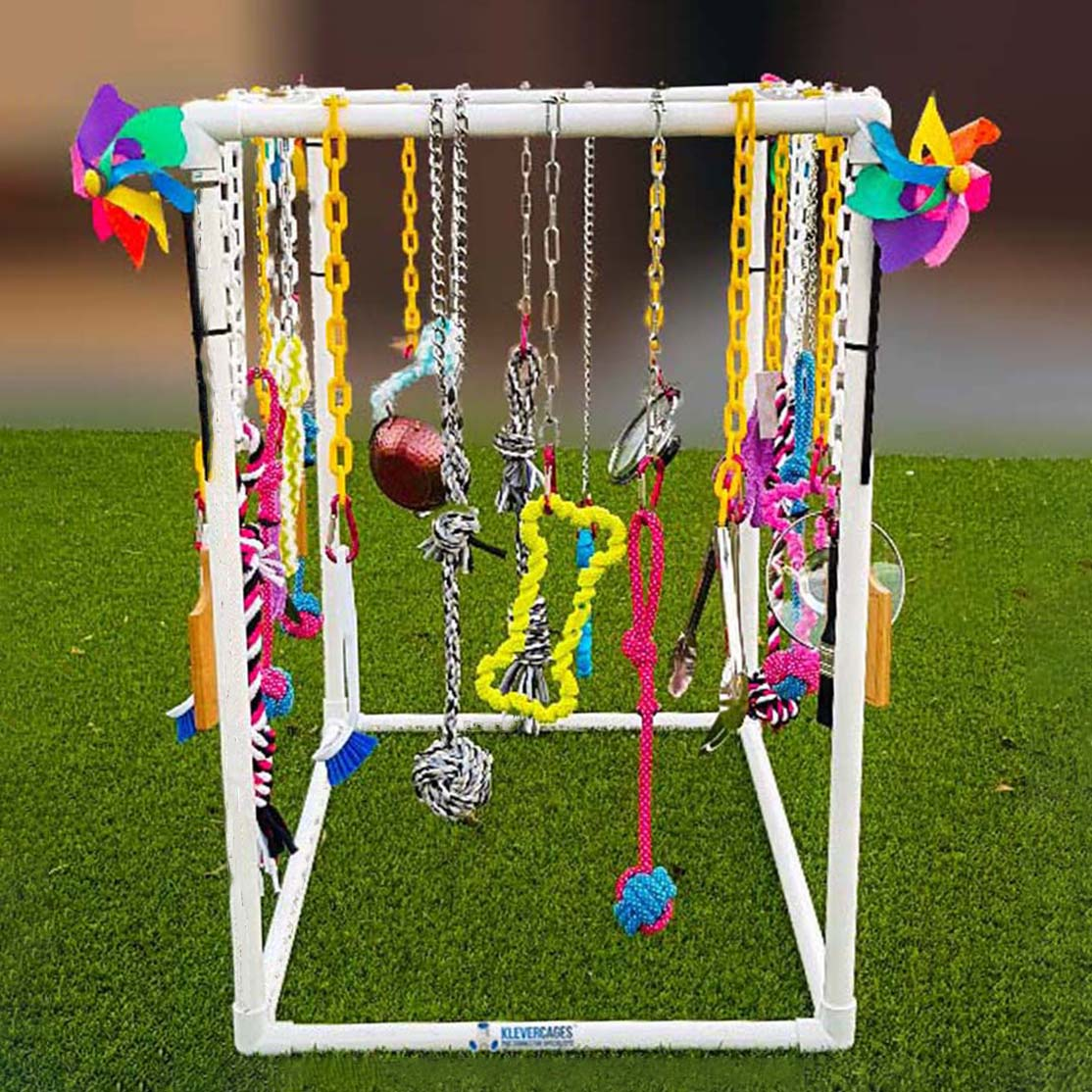 White PVC frame for puppy cat play gym with hanging toys different colour plastic chains and dog toys hanging from them