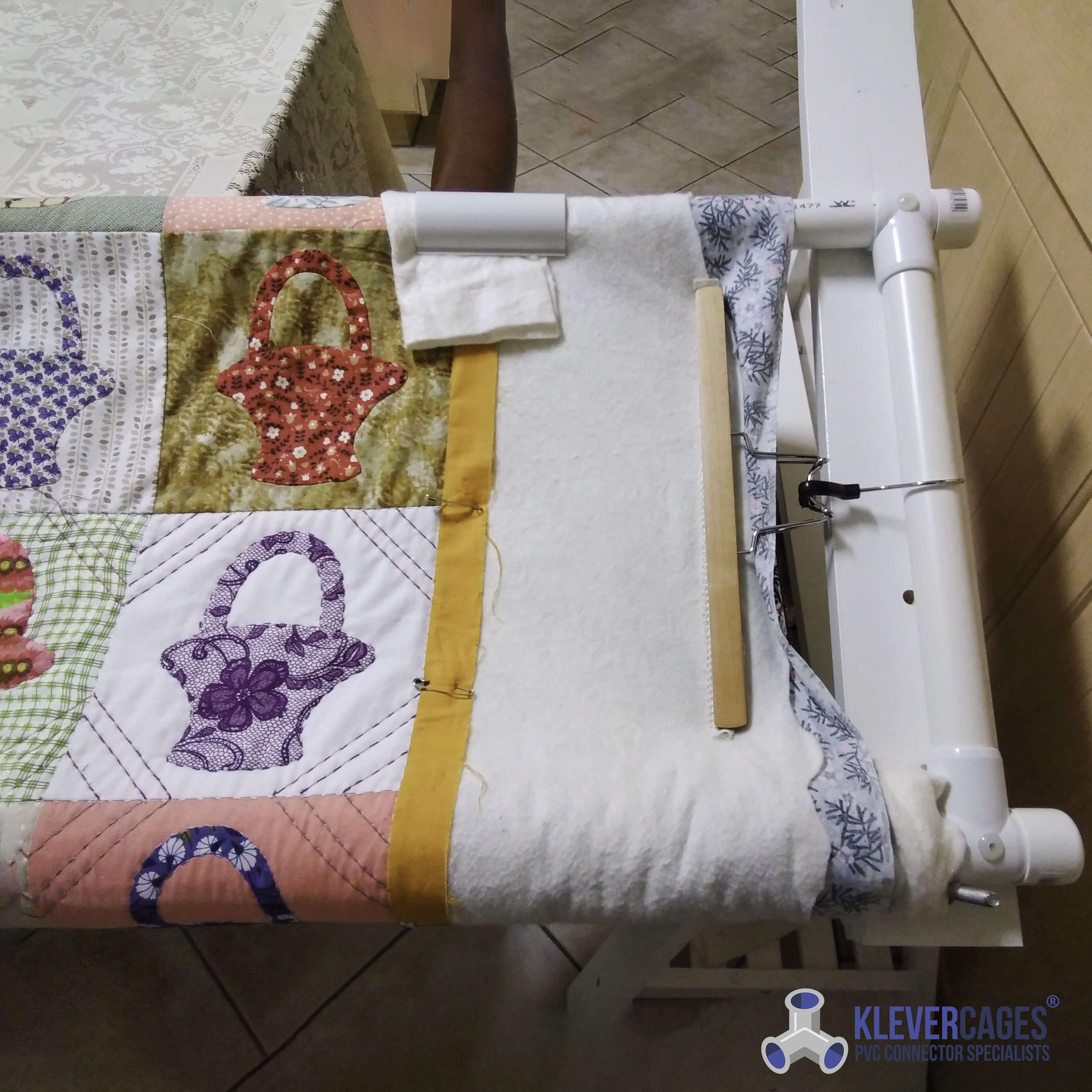 DIY quilting frame with sliding top bar using a 25mm slip tee from Klever Cages