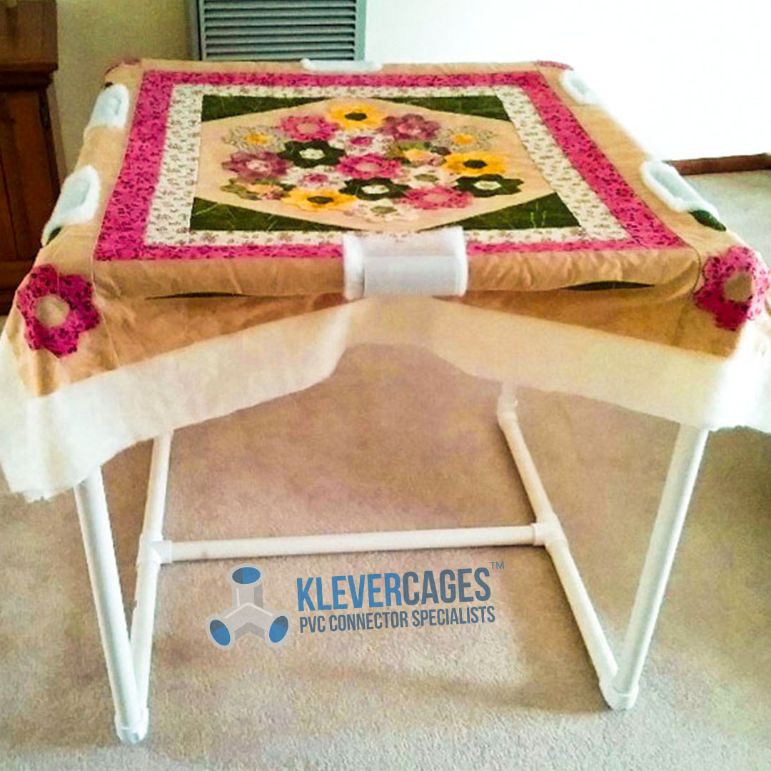 DIY quilting table with a flower pattern quilt built with PVC pipe and connectors