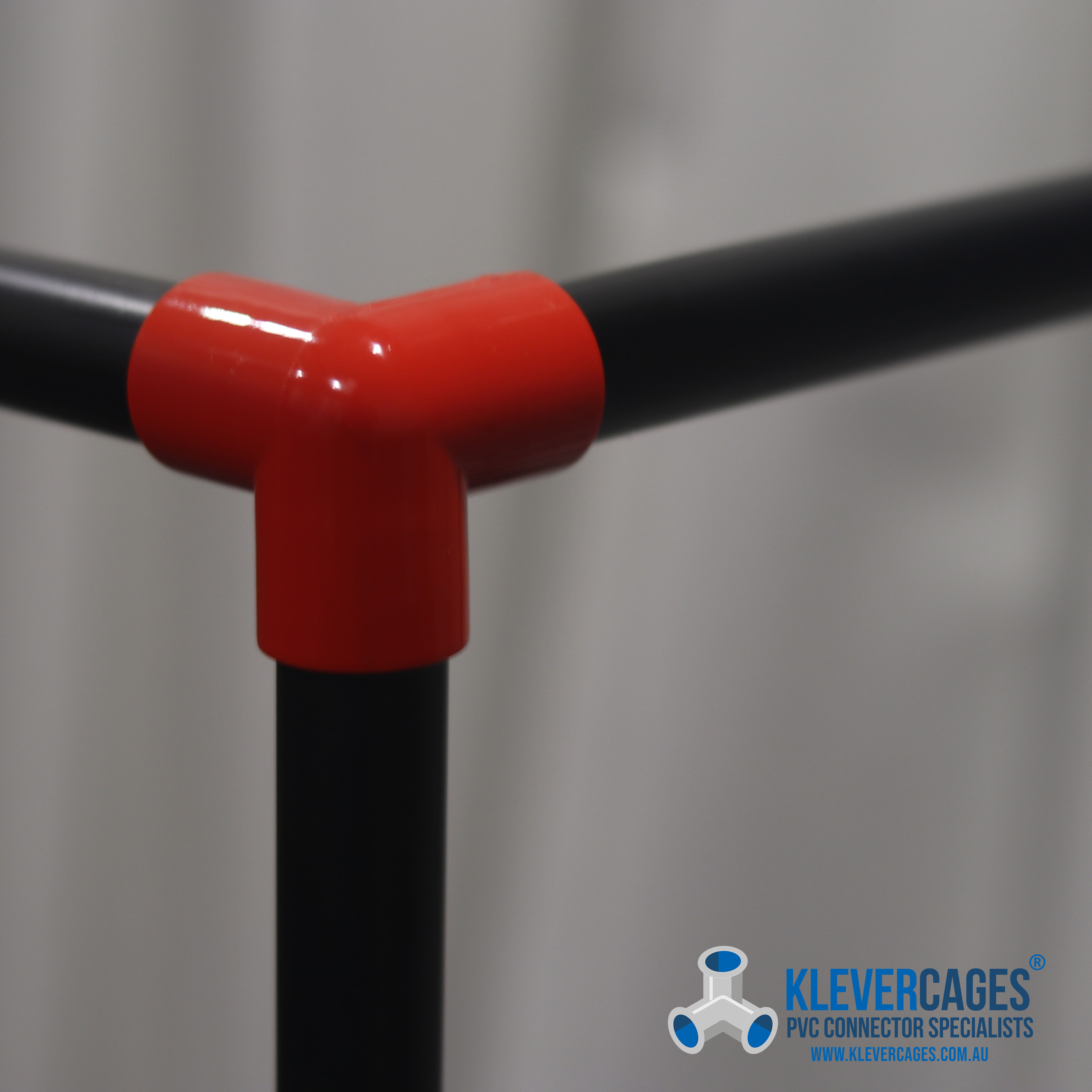 red-connector-with-black-pvc-pipe-from-klever-cages.jpg