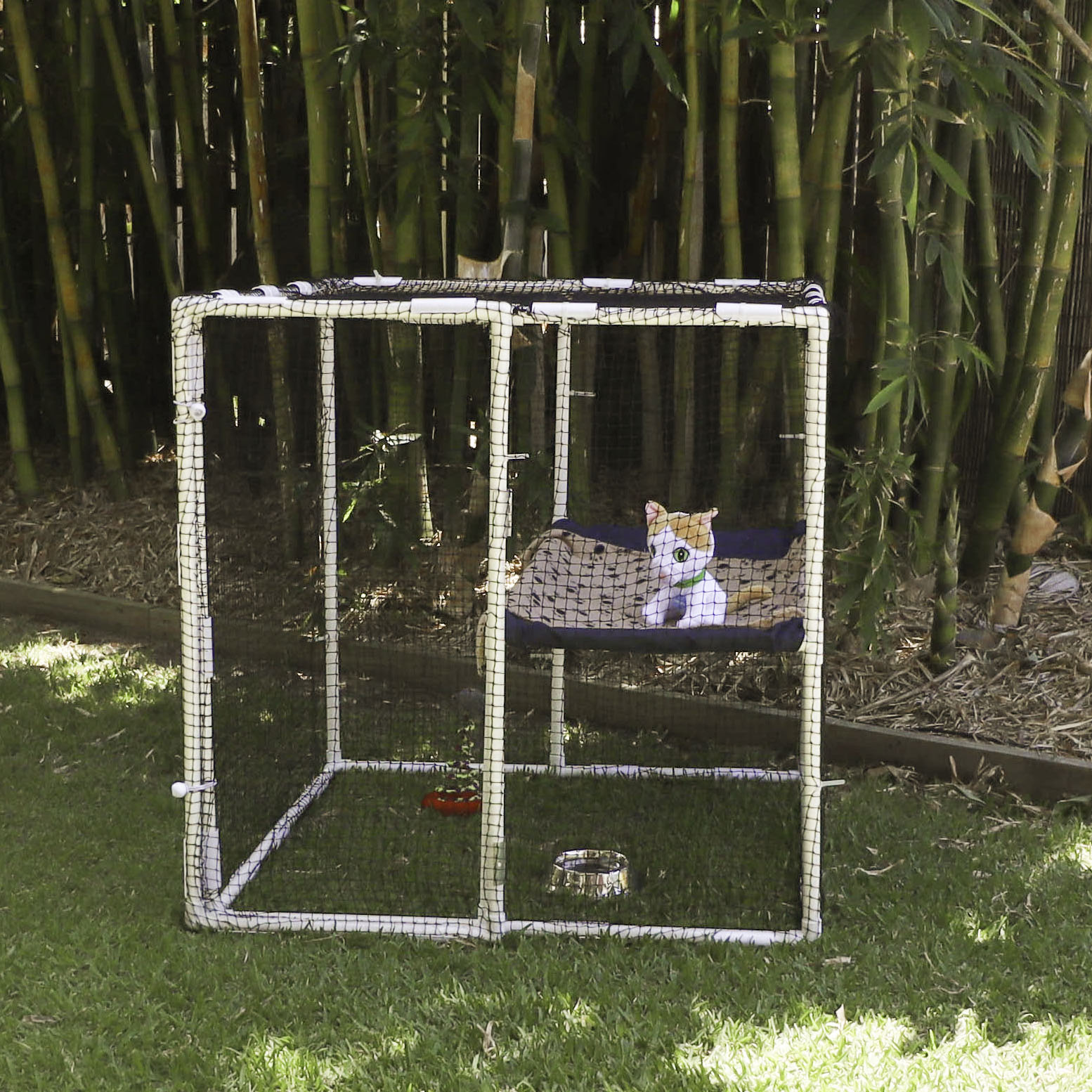 Small outdoor cat enclosure kit suitable for one cat built from PVC pipe, Klever connectors and cat netting from Klever Cages