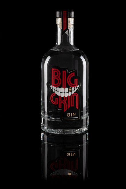 Big Grin gin bottle on black background with reflection