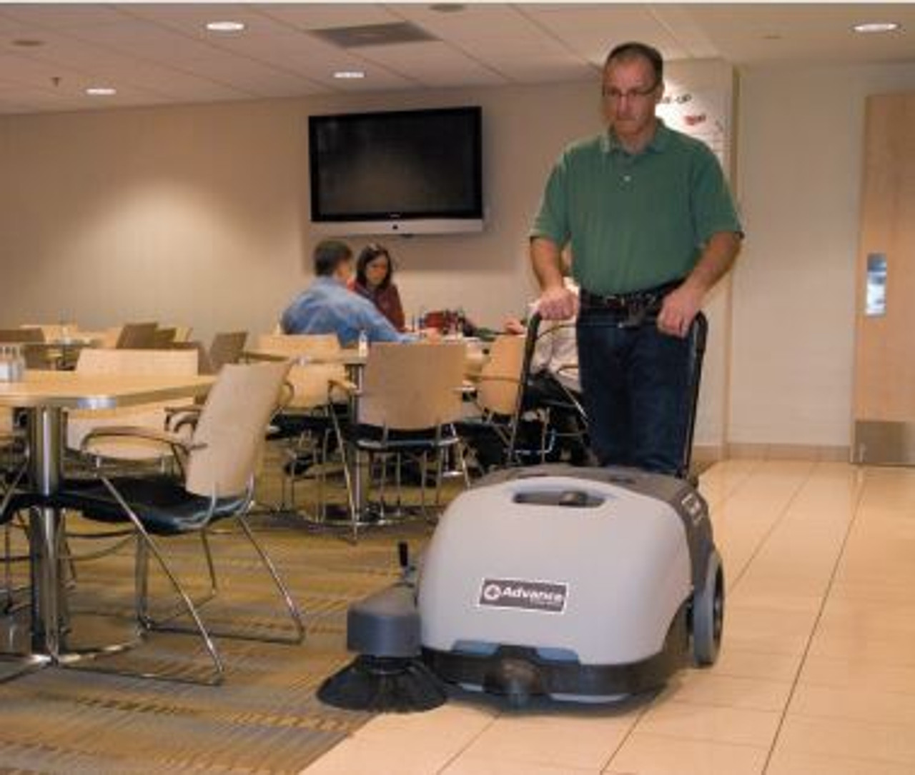 Advance Terra 28B Walk-Behind Sweeper in an Office Setting