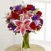 Stargazer lilies, red roses, lavender carnations, red Peruvian lilies, purple double lisianthus, purple matsumoto asters