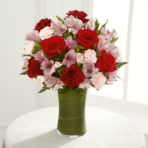 Rich red roses, burgundy carnations, pink Peruvian lilies, pink mini carnations