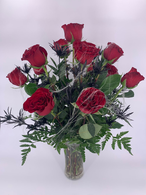 Looking to surprise your loved one during the spookiest time of year? This ghoulish bouquet of blood red roses, accented with deep black eryngium and topped with spindly spider webs is sure to put a twisted smile on anyone's face!