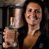 Co-founder Emma Godivala with a bottle of York Gin Chocolate & Orange in front of the copper still Ebor at the York Gin distillery.