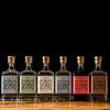 All six 70cl bottles of York Gin on a dark background. The full range.