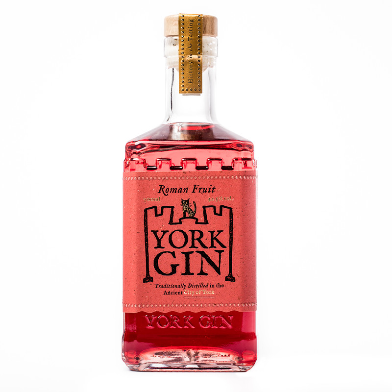 York Gin Roman Fruit bottle on white background - full strength gin with strawberry and fruit flavours and a deep red hue.