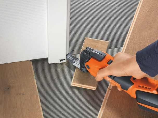 Fein Cordless MultiMaster AMM 500 Plus Top cutting the bottom of a door for floor boards