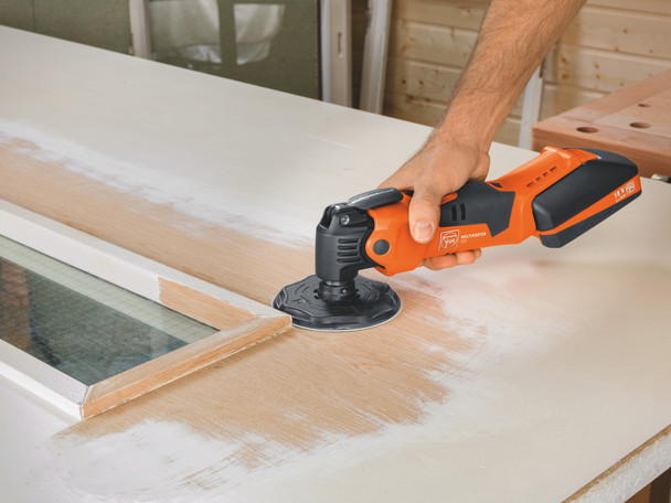 Fein Cordless MultiMaster AMM 500 Plus Top removing paint from a door