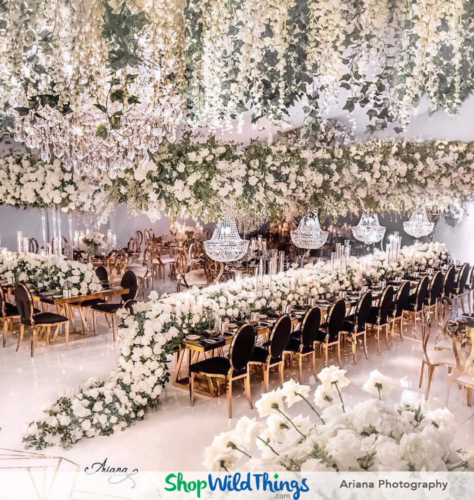 Suspended Florals and Crystal Chandeliers Elevate Tablescapes at Luxury Weddings