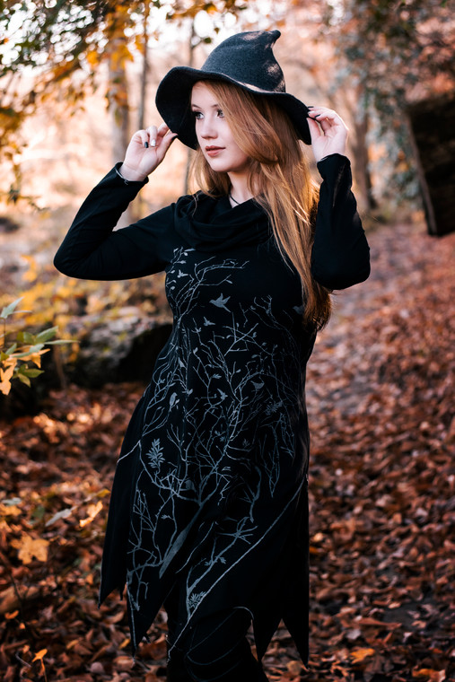 Long asymmetrical cowl neck dress with a bird and tree branch print.