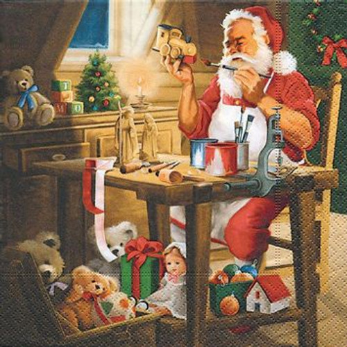 Santa painting in his workshop paper napkins