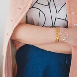 girl  woman with gold and silver bangle locket bracelet that holds two photos each