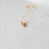 circle gold necklace locket holding one photo inside