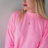 chic pink top with silver oval pendant locket necklace with a picture inside