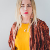 woman wearing gold heart double photo locket with yellow top and red sweater on an 18 inch chain