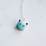 blue enameled cat face on silver locket