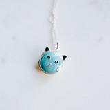 blue enameled cat face on silver locket