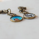 photo of girl inside keychain clip. photo of two kids inside second keychain photo clip.