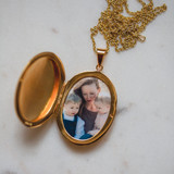 gold locket with photo inside