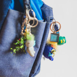 keychains for kids backpacks that have positive messages made in lockets and pendants under resin