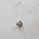 silver disco ball locket with photo of children placed inside