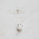white cat locket perfect for cat or kitty lovers with white kitten face and holds one or two photographs inside