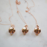 three rose gold picture lockets in modern lillian design, round and holds two pictures