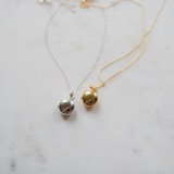The Gold Edith Locket and The Silver Edith Lockets side by side, both modern petite keepsakes