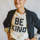 """gold edith locket on person wearing """"be kind"""" t shirt"""