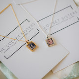 Two small square lockets.