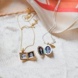 Two Lockets: One with a feather, and a small square for herself.