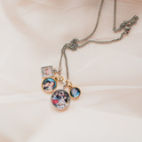 Four photos, one charm locket